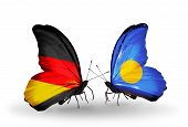 Two Butterflies With Flags On Wings As Symbol Of Relations Germany And Palau