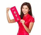 Chinese woman hold with Fai Chun, phrase meaning is dreams come ture
