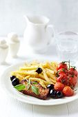 Roasted pork with french fries and cherry tomatoes
