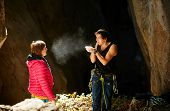 image of cave woman  - couple of  climbers standing in a cave - JPG