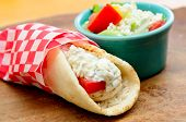 chicken pita wrap with tomato, rice and tzatziki and a side gree