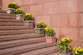 Red Stone Staircase With Flowers In Flowerpots
