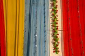 Colorful Asian Cloth And Garland Background