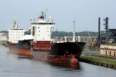 stock photo of safe haven  - two big old ships moored near embankment - JPG
