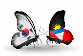 Two Butterflies With Flags On Wings As Symbol Of Relations South Korea And Antigua And Barbuda