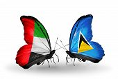 Two Butterflies With Flags On Wings As Symbol Of Relations Uae And Saint Lucia