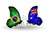 foto of brazilian money  - Two butterflies with flags on wings as symbol of relations Brazil and Australia - JPG