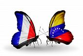 Two Butterflies With Flags On Wings As Symbol Of Relations France And Venezuela