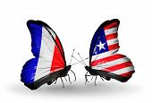 Two Butterflies With Flags On Wings As Symbol Of Relations France And Liberia
