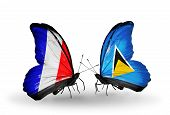 Two Butterflies With Flags On Wings As Symbol Of Relations France And Saint Lucia