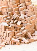 Pile Of Red Bricks At Construction Site.