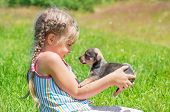 stock photo of little puppy  - A child on a walk with a little puppy - JPG