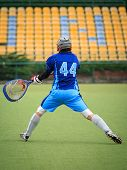 pic of lax  - lacrosse players on a playing field during the match - JPG