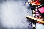 pic of dark-skin  - Various makeup products on dark background with copyspace - JPG