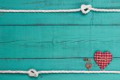 Blank blue sign with white rope border, red heart, bronze key and lock