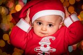 picture of backround  - Little 9 months old boy dressed in Christmas outfit with a backround bokeh of Christmas tree lights - JPG