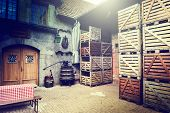 image of wine-press  - Old winery backyard with empty wooden crates - JPG