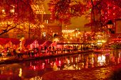 Blurred Holiday Background. River Walk  In San Antonio City At Night In Christmas Season