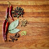 Dried Red Chili Peppers And Spices On Rustic, Dark Wood Cutting Board.