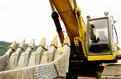 image of track-hoe  - A large tracked excavator at an construction site - JPG