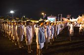BANGKOK, THAILAND - DEC 05, 2014: Unidentified participants in the celebration of the 87th birthday of Thailand King Bhumibol Adulyadej, is also known as Rama IX, ninth monarch of Chakri Dynasty.