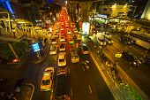 BANGKOK, THAILAND - DEC 18, 2014: Traffic jam in city centre at night. Bangkok's traffic problem getting worse, since government in 2012 introduced a policy to refund tax for first-time car buyers.