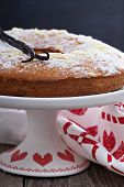 stock photo of cake stand  - Vanilla and almond cake on a cake stand powdered with sugar - JPG