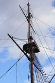 pic of mast  - Crowsnest on the mast of a historic battleship and the rigging around the mast - JPG