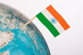 stock photo of indian flag  - Indian flag pointing on New Delhi in  globe - JPG