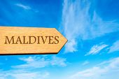 Wooden arrow sign pointing destination MALDIVES poster