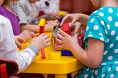 stock photo of nursery school child  - children hands building towers out of wooden bricks - JPG
