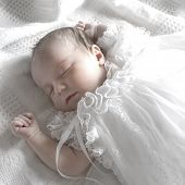 pic of born  - New born baby girl dressed in white asleep on a white blanket - JPG