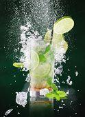 stock photo of freezing  - fresh mojito drink with liquid splash and drift - JPG