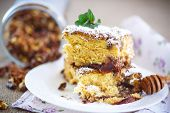 stock photo of pecan nut  - sweet honey cake with nuts and plums - JPG