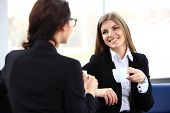 pic of chat  - Office workers on coffee break woman enjoying chatting to colleagues smiling - JPG