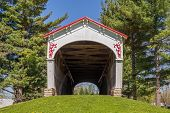 stock photo of covered bridge  - The Longwood Covered Bridge now located in Connersville Indiana was built in 1884 over Williams Creek by Kennedy Brothers - JPG