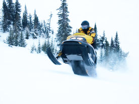 image of winter sport  - ski doo going fast and jumping in winter - JPG