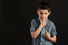 image of thinkers pose  - Boy posing confidently with hand on chin while making number one sign - JPG