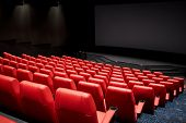 entertainment and leisure concept - movie theater or cinema empty auditorium with red seats poster