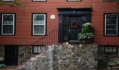 stock photo of marblehead  - black door on red house built in 1720 for samuel russell merchant - JPG