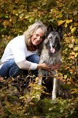 blond woman with Belgian shepherd