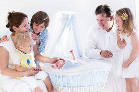 pic of bassinet  - Big family with four kids in white bedroom - JPG