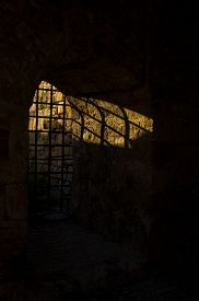 pic of dungeon  - Sunlight through the dungeon bars at Kalemegdan fortress - JPG