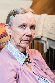 picture of matron  - Retro style old woman seated and looking at camera - JPG