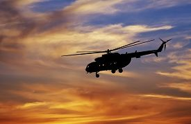 stock photo of helicopters  - Picture of helicopter at sunset - JPG