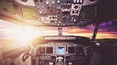 Aircraft interior, cockpit view inside the airliner. Point of view from a pilot place in a plane. Su poster