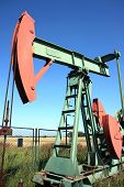 foto of nonrenewable  - red and green small crude well in europe - JPG