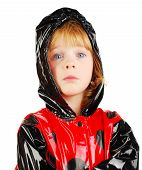Child With Funny Face  In Rain Coat.