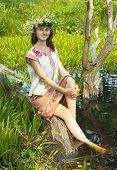stock photo of undine  - Pretty girl in flower chaplet at river - JPG
