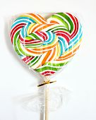 Close up of colourful lollipop, heart shape.